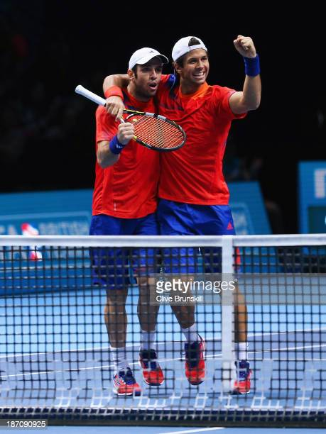 David Marrero and Fernando Verdasco of Spain celebrate victory in their men's doubles match against Leander Paes of India and Radek Stepanek of the...