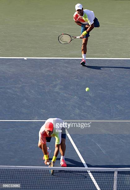 David Marrero and Fernando Verdasco of Spain in action against Mike Bryan and Bob Bryan of the United States during their third round Men's Doubles...