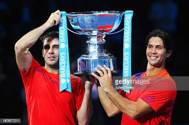 David Marrero and Fernando Verdasco of Spain pose with the trophy after victory in their men's doubles final match against Bob and Mike Bryan of the...