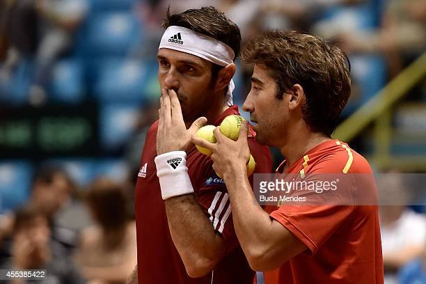 David Marrero and Marc Lopez of Spain talk during their playoff doubles match against Bruno Soares and Marcelo Melo of Brazil on Day Two of the Davis...
