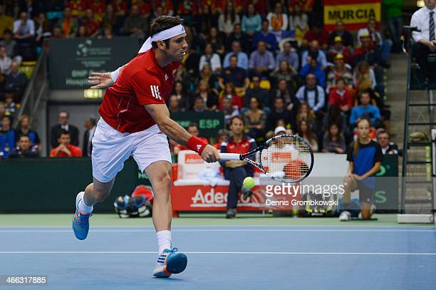 David Marrero of Spain plays a forehand in his Double match with Fernando Verdasco against Tommy Haas and Philipp Kohlschreiber of Germany on Day 2...