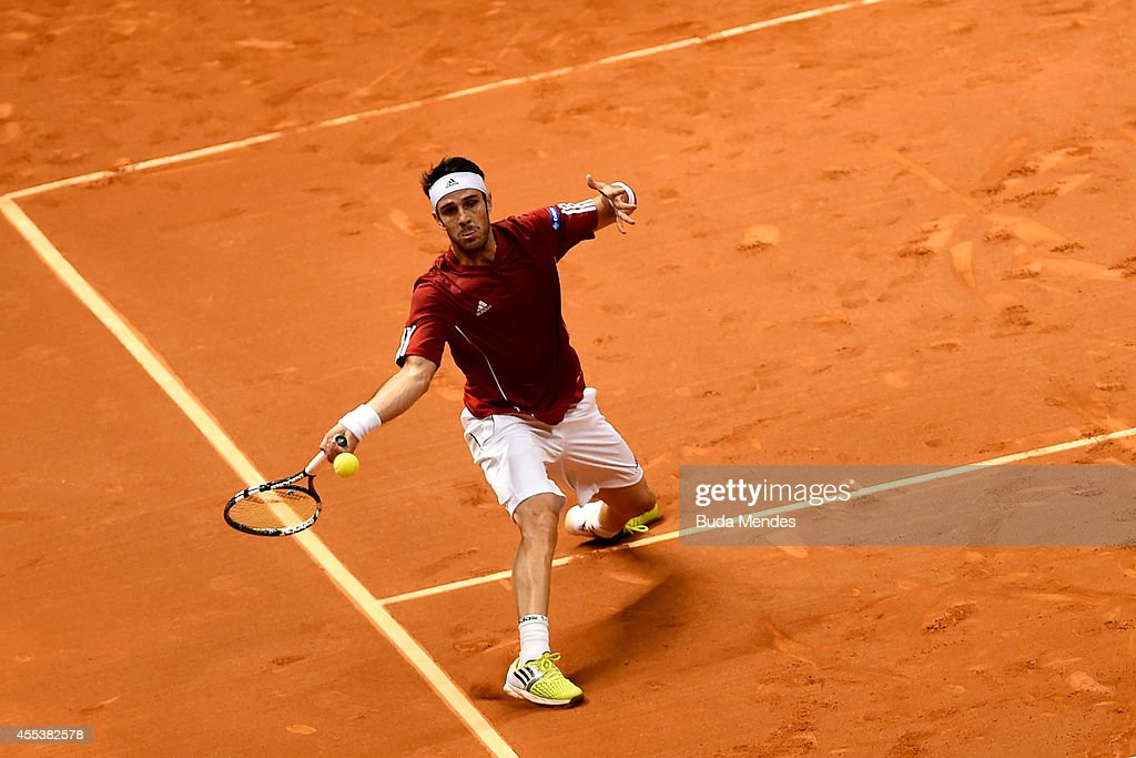 <a gi-track='captionPersonalityLinkClicked' href=/galleries/search?phrase=David+Marrero&family=editorial&specificpeople=5357971 ng-click='$event.stopPropagation()'>David Marrero</a> of Spain returns a shot during his play-off doubles match against Bruno Soares and Marcelo Melo of Brazil on Day Two of the Davis Cup at Ibirapuera Gymnasium on September 13, 2014 in Sao Paulo, Brazil.