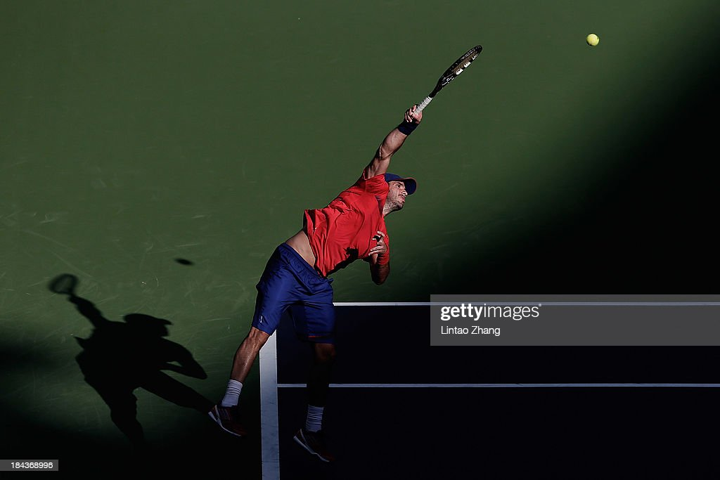 David Marrero of Spain serves to Marcelo Melo of Brazil and Ivan Dodig of Croatia during the doubles final of the Shanghai Rolex Masters at the Qi Zhong Tennis Center on October 13, 2013 in Shanghai, China.