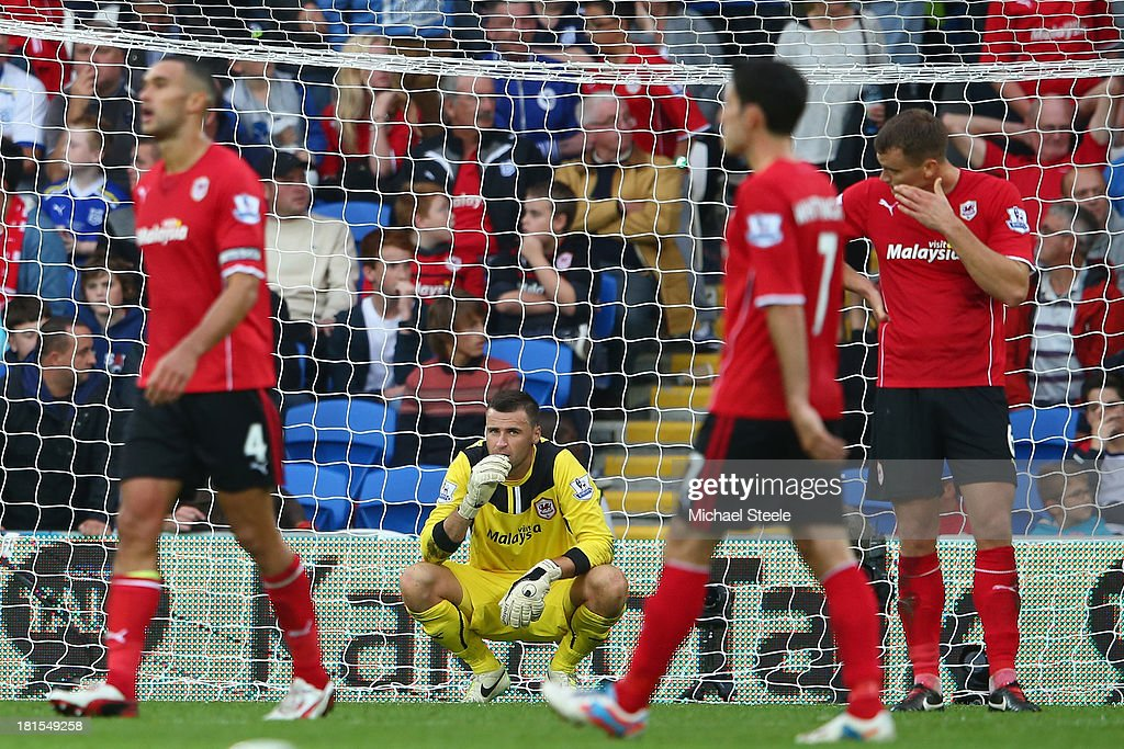 David Marshall (2L) the goalkeeper of Cardiff City is left distraught after conceding a last minute goal scored by Paulinho of Tottenham Hotspur during the Barclays Premier League match between Cardiff City and Tottenham Hotspur at Cardiff City Stadium on September 22, 2013 in Cardiff, Wales.