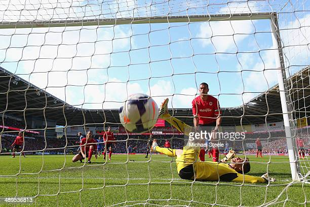 David Marshall the goalkeeper of Cardiff City is left grounded after Andre Schurrle of Chelsea scores the equalising goal during the Barclays Premier...