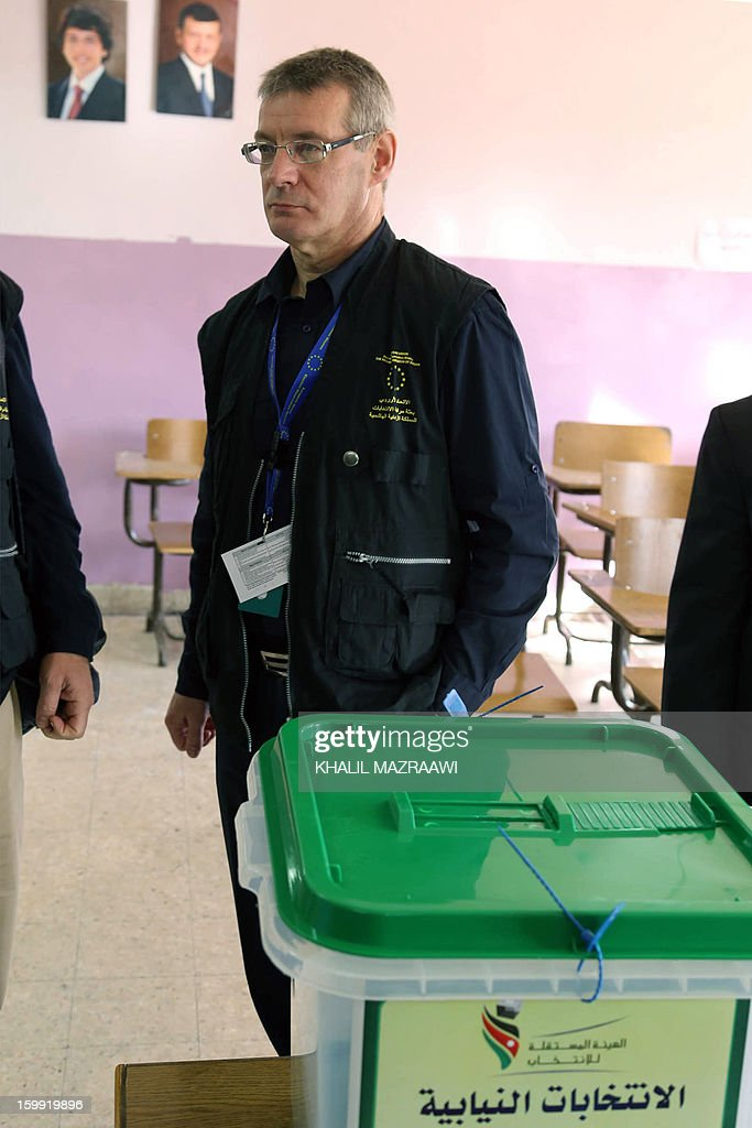 David Martin, chief observer of European Union Election Observing Mission (EU EOM) visits a polling station in Amman, on January 23, 2013. Jordanians voted in a parliamentary poll snubbed by Islamists who have staged strident pro-reform protests and have already slammed as illegitimate what is expected to be an opposition-free body.
