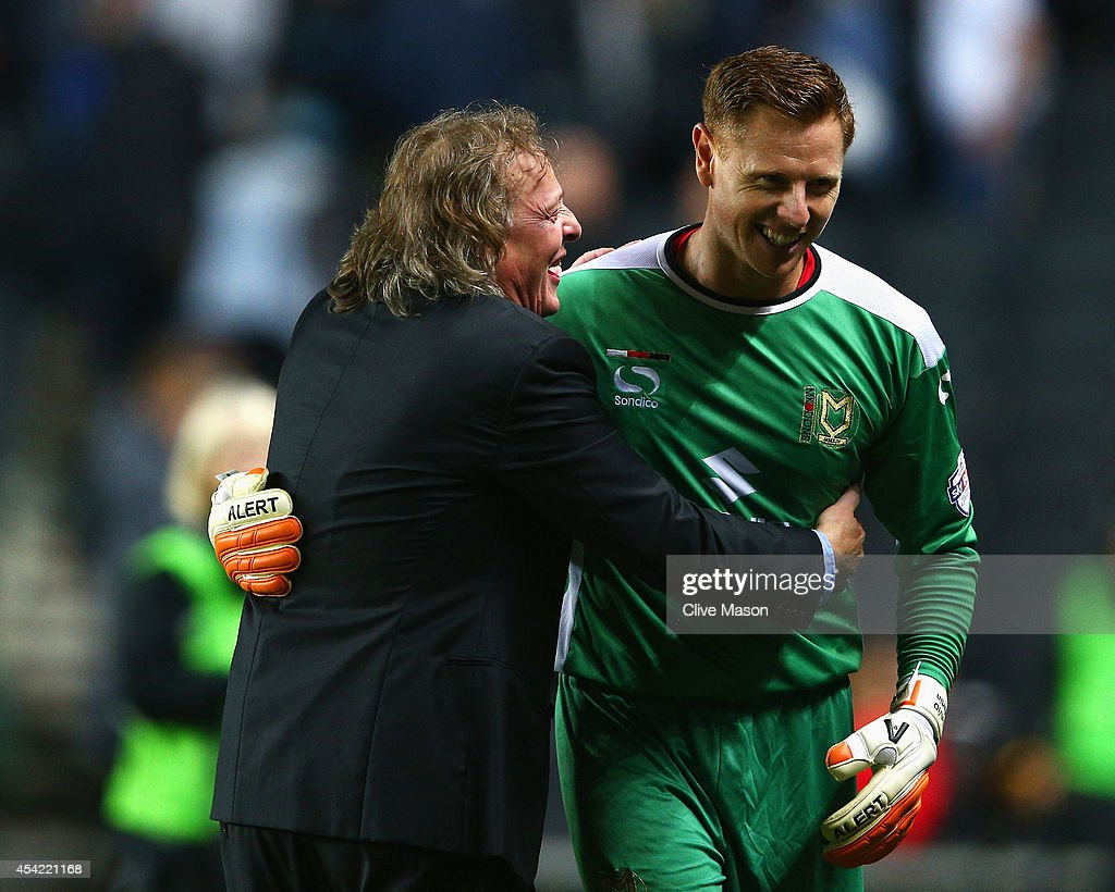David Martin of Milton Keynes Dons is congratulated by chairman Pete Winkleman after the Capital One Cup Second Round match between MK Dons and Manchester United at Stadium mk on August 26, 2014 in Milton Keynes, England.
