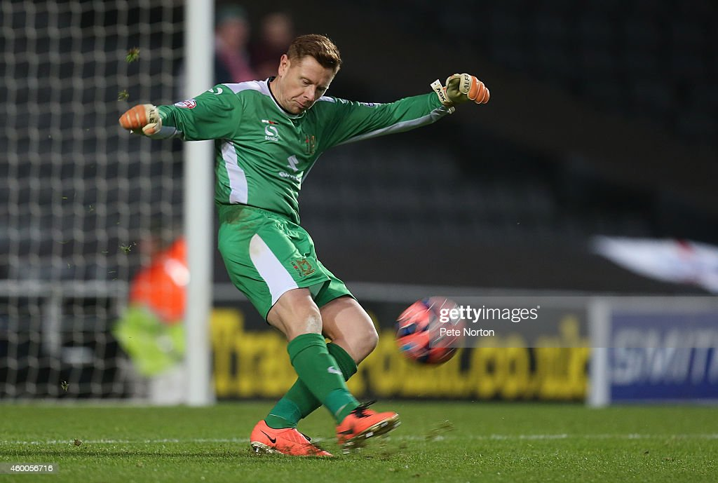 David Martin of MK Dons in action during the FA Cup Second Round match between MK Dons and Chesterfield at Stadium mk on December 6, 2014 in Milton Keynes, England.