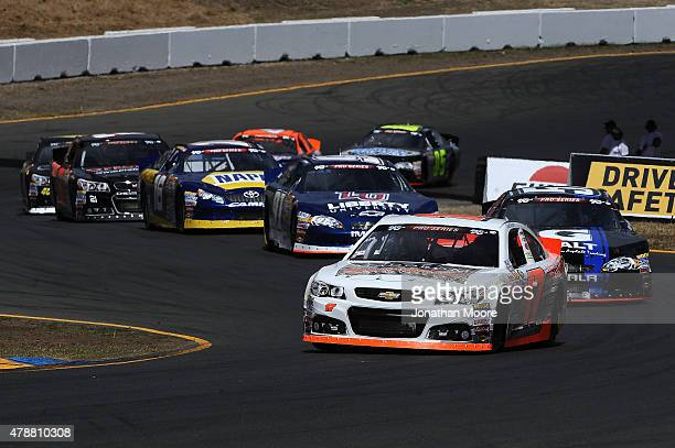 David Mayhew driver of the MMI Racing/Ron's Rear Ends/Pour House Chevrolet after a green flag restart during the NASCAR KN Pro Series West Carneros...