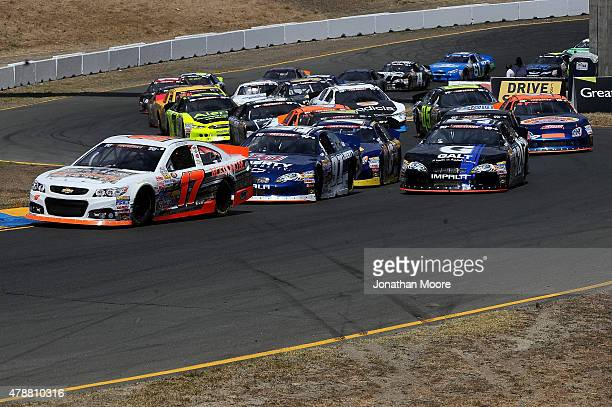 David Mayhew driver of the MMI Racing/Ron's Rear Ends/Pour House Chevrolet leads at the start of the NASCAR KN Pro Series West Carneros 200 at Sonoma...