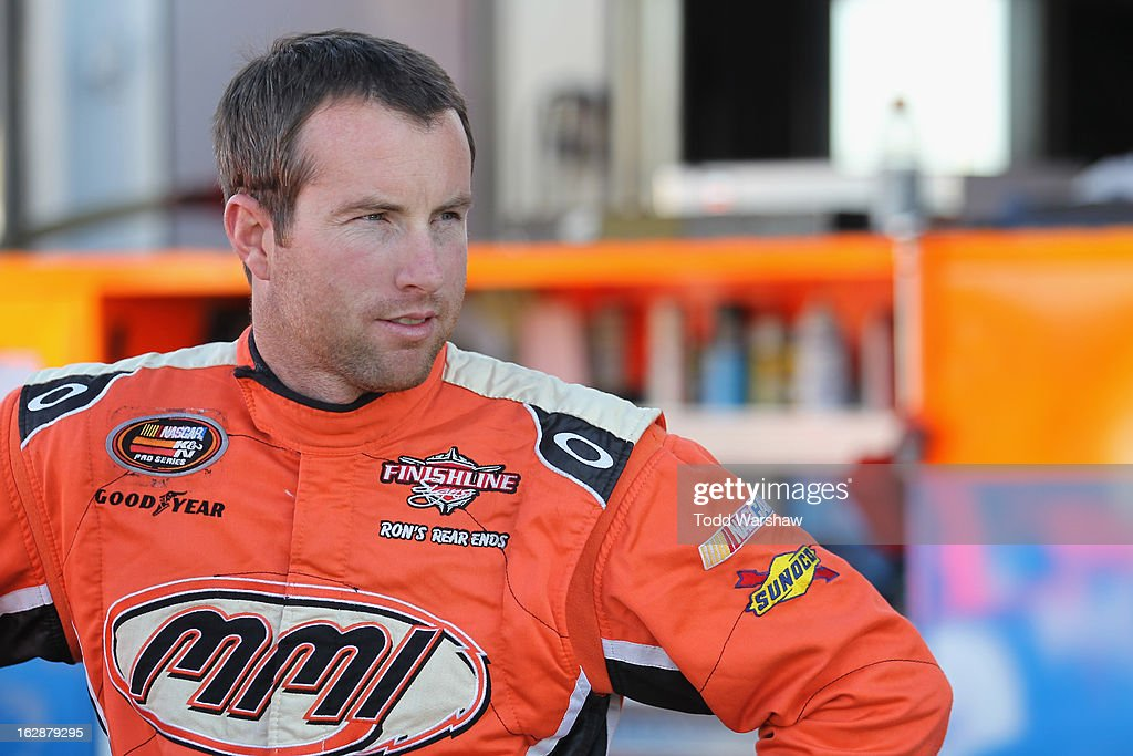 David Mayhew, driver of the #17 MMI Services/Ron's Rear Ends Chevrolet, stands in the garage during NASCAR K&N Pro Series West practice for the Talking Stick Resort 60 at Phoenix International Raceway on February 28, 2013 in Avondale, Arizona.