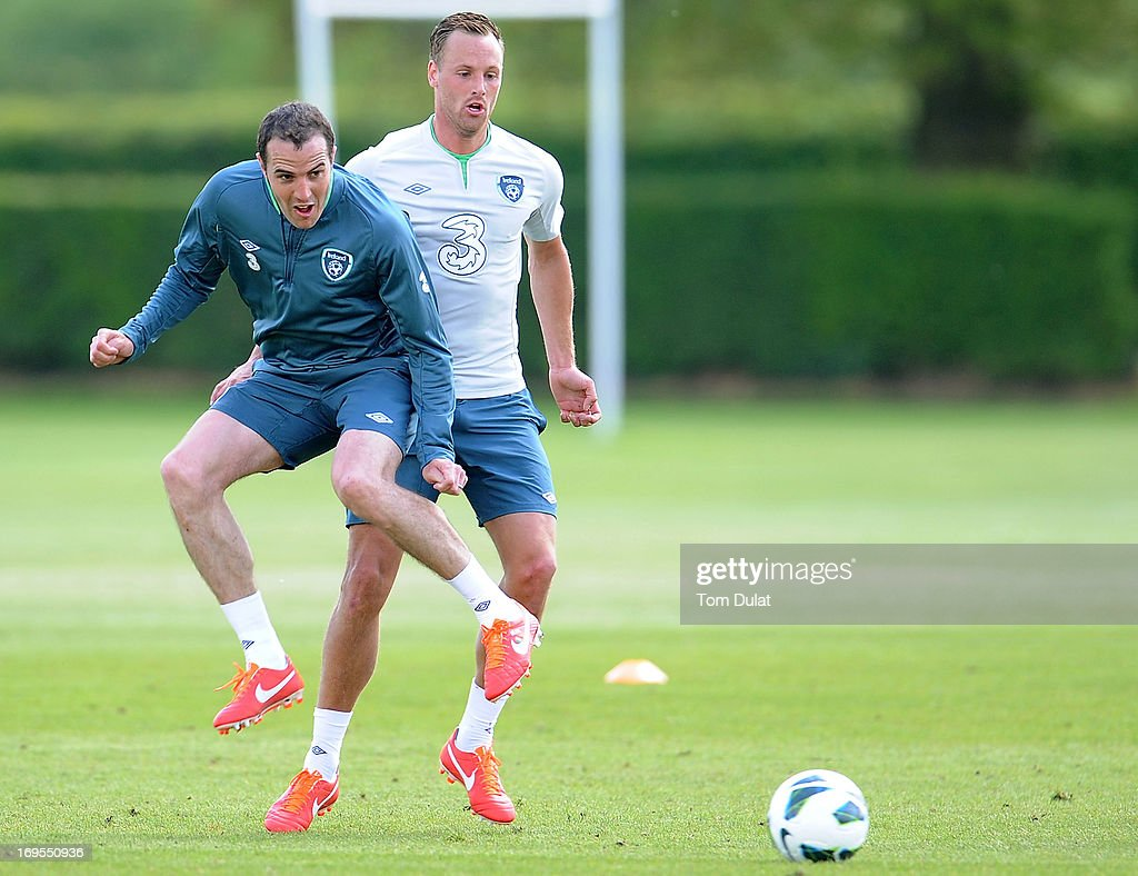 David Mayler (R) and John O'Shea (L) in action during the Ireland training session at Watford FC Training Ground on May 27, 2013 in London Colney, England.
