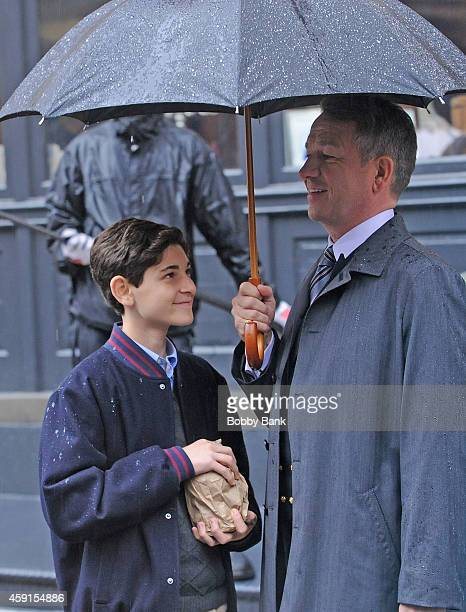David Mazouz who plays 'Bruce Wayne' and Sean Pertwee who plays 'Alfred Pennyworth' on the set of 'Gotham' on November 17 2014 in New York City
