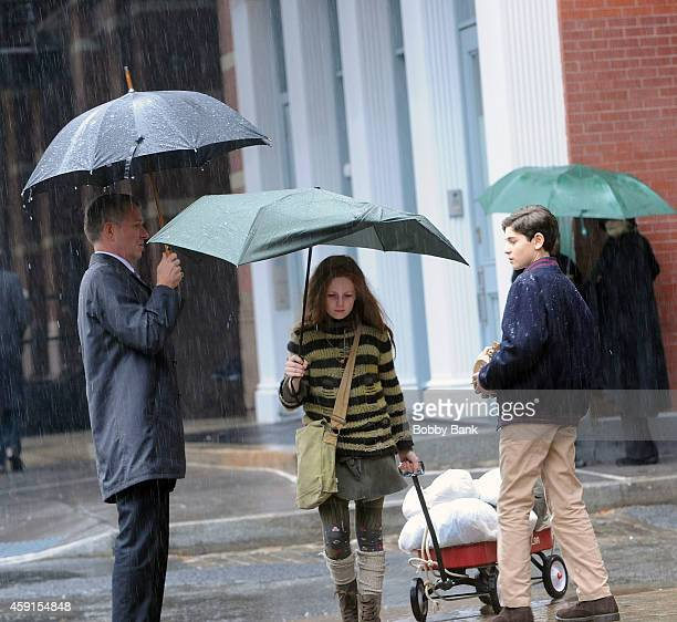David Mazouz who plays 'Bruce Wayne' Sean Pertwee who plays 'Alfred Pennyworth' and Clare Foley who plays 'Ivy Pepper/Poison Ivy' on the set of...