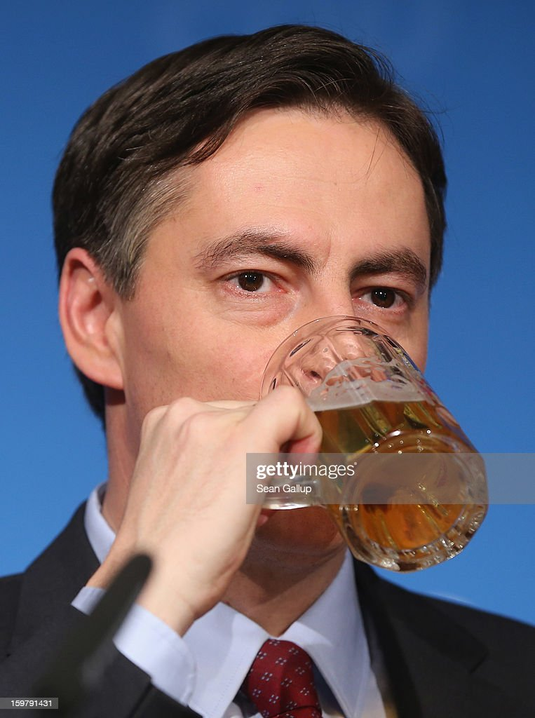David McAllister (C), incumbent gubernatorial candidate of the German Christian Democrats (CDU), sips a beer after speaking to supporters at the CDU election night party following elections in Lower Saxony that left a possible hairline win for a Social Democrats (SPD) and Greens Party coalition on January 20, 2013 in Hanover, Germany. Many see the Lower Saxony election as a bellwether for national elections scheduled for later this year.