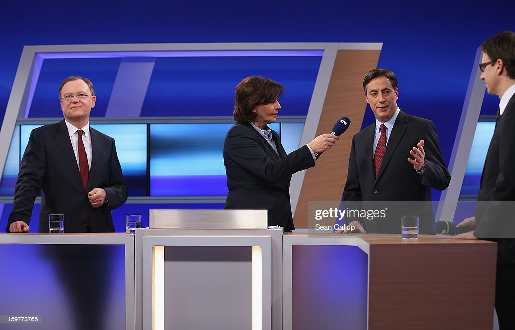 David McAllister (2nd from R), incumbent gubernatorial candidate of the German Christian Democrats (CDU), speaks on a television news show as Social Democrats (SPD) candidate Stephan Weil (L) and Liberal Democrats (FDP) candidate Stefan Birkner (R) look on after initial poll results gave the CDU the highest number of votes following elections in Lower Saxony on January 20, 2013 in Hanover, Germany. Many see the Lower Saxony election as a bellwether for national elections scheduled for later this year.