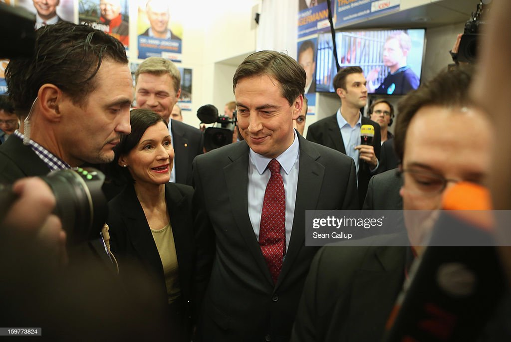David McAllister, incumbent gubernatorial candidate of the German Christian Democrats (CDU), departs with his wife Dunja after speaking to supporters after initial poll results gave the CDU the highest number of votes following elections in Lower Saxony on January 20, 2013 in Hanover, Germany. Many see the Lower Saxony election as a bellwether for national elections scheduled for later this year.