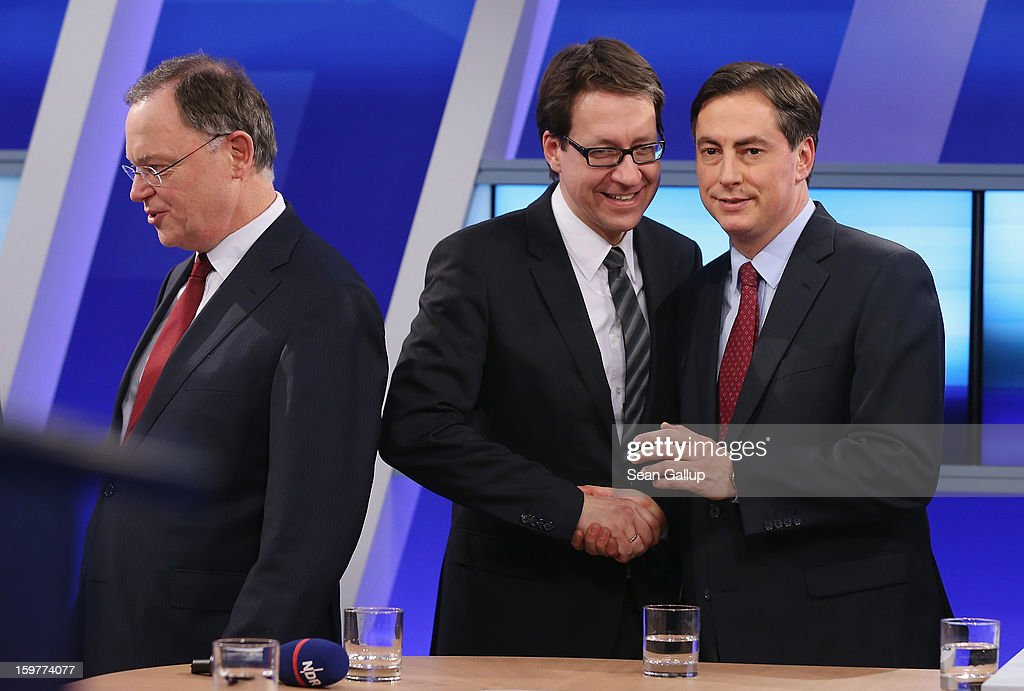 David McAllister ( R), incumbent gubernatorial candidate of the German Christian Democrats (CDU), shakes hands with Liberal Democrats (FDP) candidate Stefan Birkner on a television news show as Social Democrats (SPD) candidate Stephan Weil (L) walks by after initial poll results gave the CDU the highest number of votes following elections in Lower Saxony on January 20, 2013 in Hanover, Germany. Many see the Lower Saxony election as a bellwether for national elections scheduled for later this year.