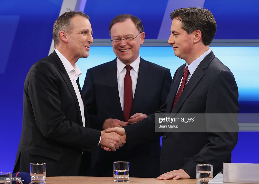 David McAllister ( R), incumbent gubernatorial candidate of the German Christian Democrats (CDU), shakes hands with Greens Party candidate Stefan Wenzel on a television news show as Social Democrats (SPD) candidate Stephan Weil (C) looks on after initial poll results gave the CDU the highest number of votes following elections in Lower Saxony on January 20, 2013 in Hanover, Germany. Many see the Lower Saxony election as a bellwether for national elections scheduled for later this year.