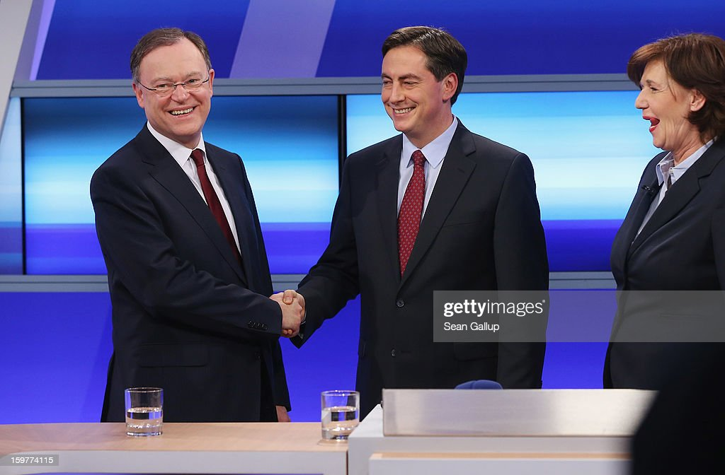 David McAllister (C), incumbent gubernatorial candidate of the German Christian Democrats (CDU), shakes hands with Social Democrats (SPD) candidate Stephan Weil (L) following a television news interview after initial poll results gave the CDU the highest number of votes following elections in Lower Saxony on January 20, 2013 in Hanover, Germany. Many see the Lower Saxony election as a bellwether for national elections scheduled for later this year.