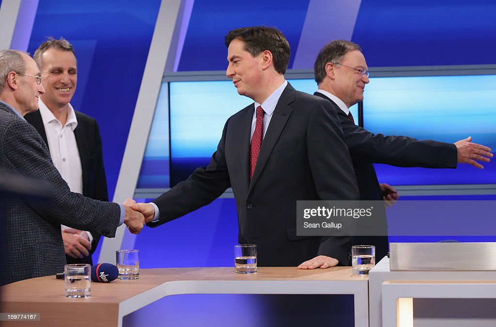 David McAllister (C), incumbent gubernatorial candidate of the German Christian Democrats (CDU), shakes hands with Die Linke candidate Manfred Sohn (L) as Greens Party candidate Stefan Wenzel looks on and Social Democrats (SPD) candidate Stephan Weil (R) greets someone else following a television news interview after initial poll results gave the CDU the highest number of votes following elections in Lower Saxony on January 20, 2013 in Hanover, Germany. Many see the Lower Saxony election as a bellwether for national elections scheduled for later this year.