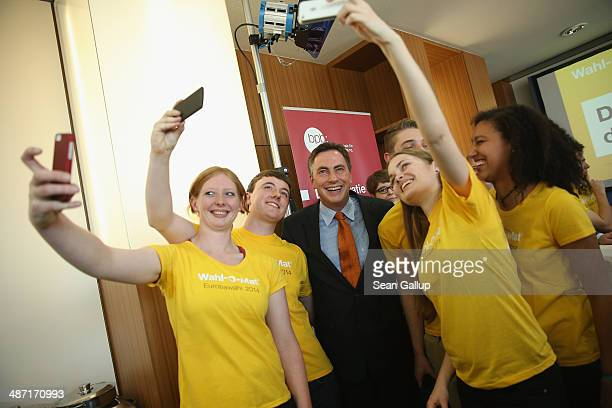 David McAllister lead candidate of the German Christian Democrats in upcoming European parliamentary elections poses for a selfie with volunteers at...