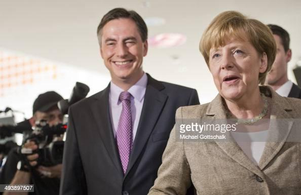 David McAllister Top Candidate of German CDU Party and German Chancellor Angela Merkel attend a press conference in KonradAdenauerHaus on May 26 2014...