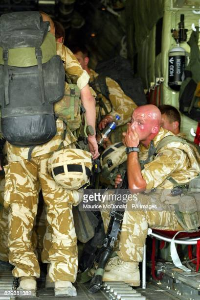 David McBride of the Black Watch wipes the sweat off his face as he sits aboard a Hercules C130 at Basra International Airport where temperatures are...