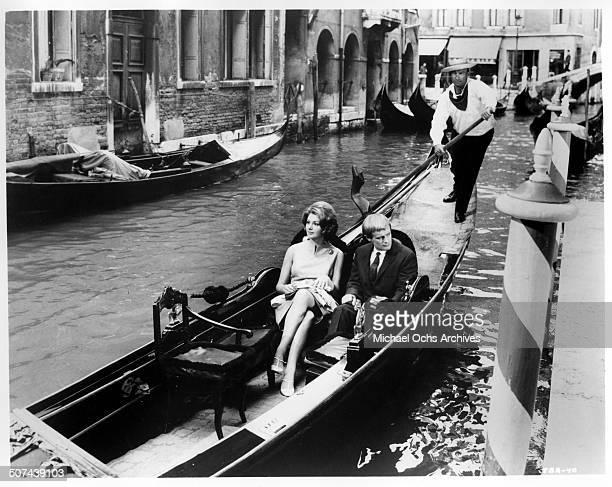 David McCallum and Sylva Koscina take a gondola ride in a scene from the MGM movie 'Three Bites of the Apple' circa 1967
