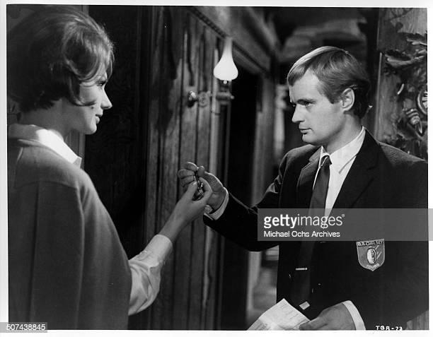 David McCallum shows Sylva Koscina her room in a scene from the MGM movie 'Three Bites of the Apple' circa 1967