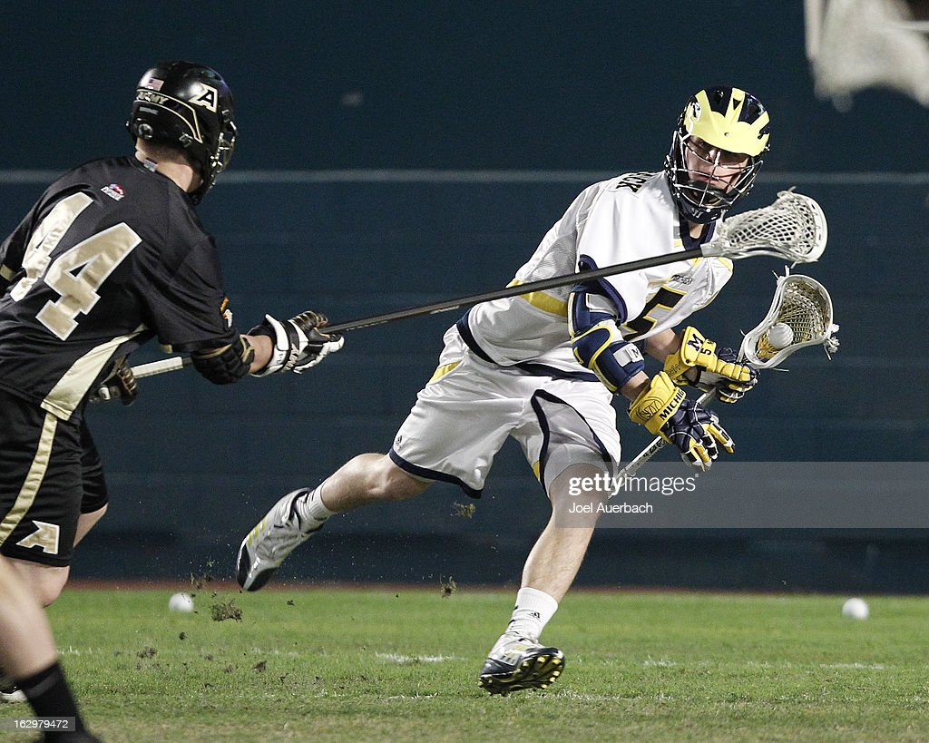 David McCormack #5 of the Michigan Wolverines attempts to pass the ball while being pressured by John Burk #44 of the Army Black Knights during the 2013 Orange Bowl Lacrosse Classic on March 2, 2013 at SunLife Stadium in Miami Gardens, Florida.