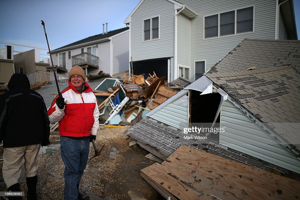 David Mccue finds a golf club and the roof to his beach house that was completely demolished by Superstorm Sandy on November 25, 2012 in Ortley Beach, New Jersey. New Jersey Gov. Christie estimated that Superstorm Sandy cost New Jersey $29.4 billion in damage and economic losses.