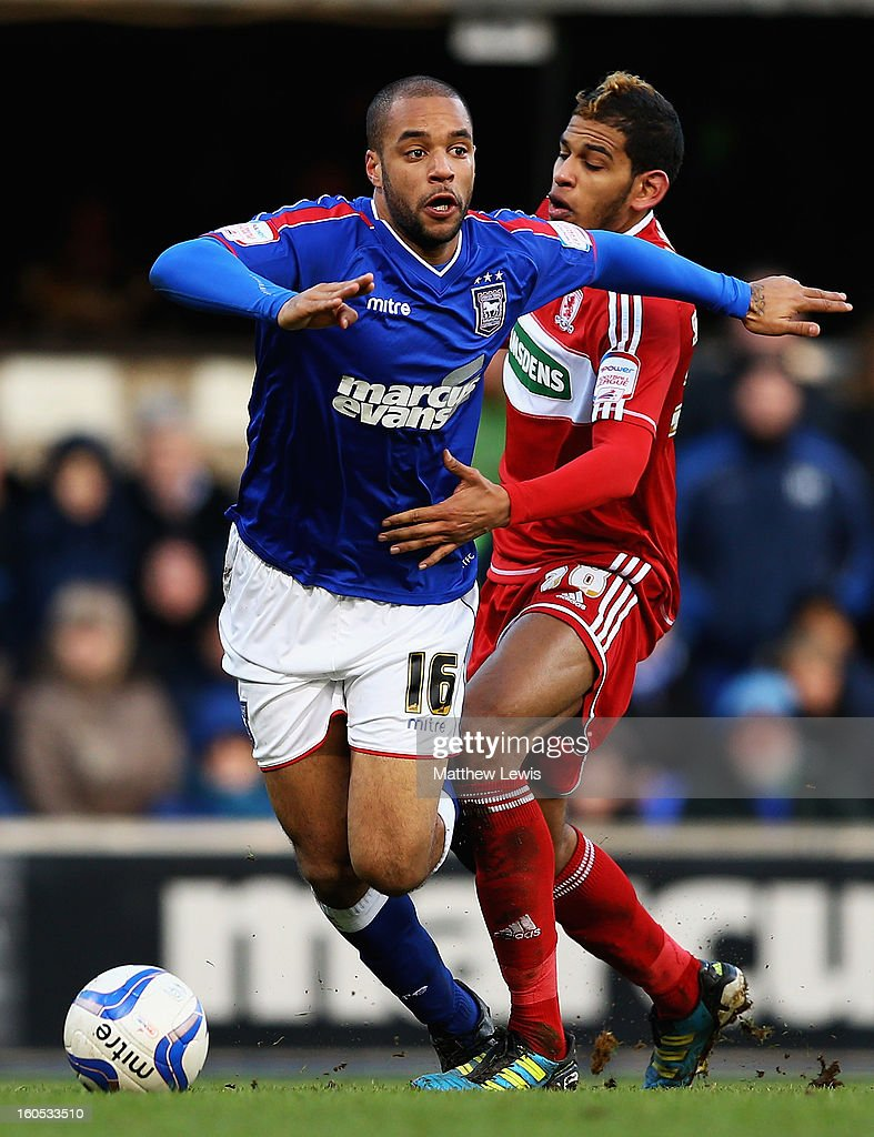 David McGoldrick of Ipswich holds off Faris Haroun of Middlesbrough during the npower Championship match between Ipswich Town and Middlesbrough at Portman Road on February 2, 2013 in Ipswich, England.