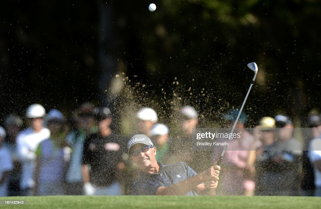 David McKenzie of Australia hits out of the bunker on the 16th hole during day three of the PGA Royal Pines on November 9 2013 in Gold Coast Australia