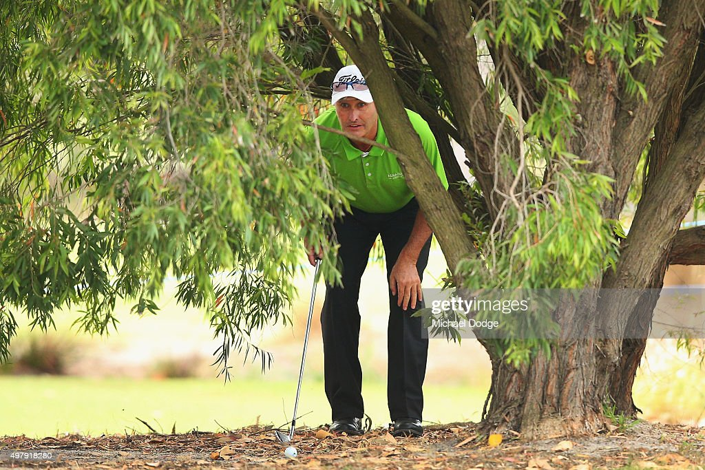 David McKenzie of Australia ines up an approach shot on the 10th hole during day two of the 2015 Australian Masters at Huntingdale Golf Club on...