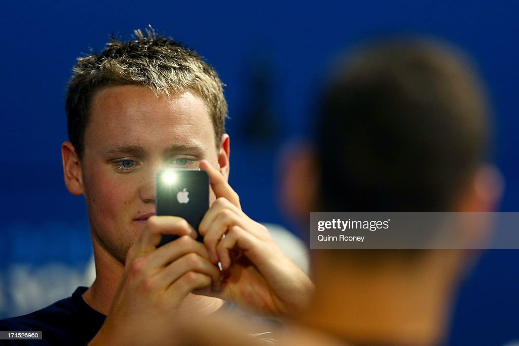 David McKeon of Australia takes a photo during a swim training session on day eight of the 15th FINA World Championships at Palau Sant Jordi on July 27, 2013 in Barcelona, Spain.