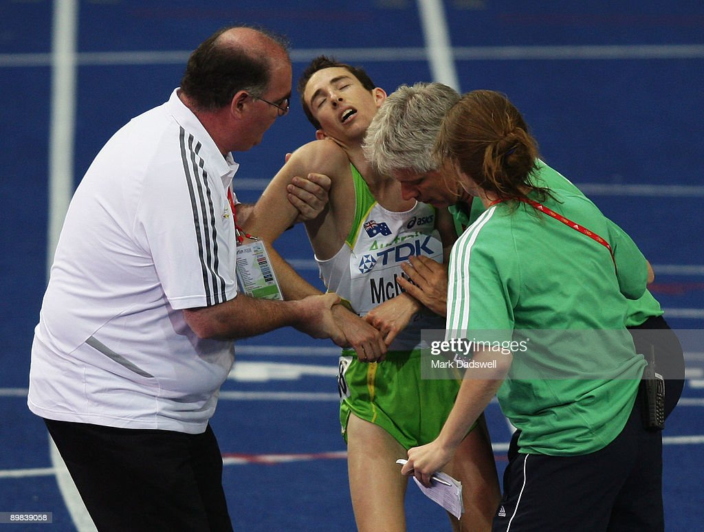 David Mcneill of Australia receives help after he competed in the men's 10,000 Metres Final during day three of the 12th IAAF World Athletics Championships at the Olympic Stadium on August 17, 2009 in Berlin, Germany.