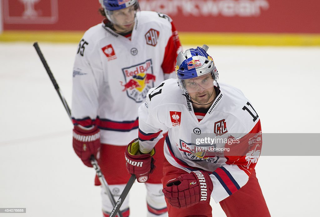 David Meckler #55 and team mate Ben Walter #11 of Red Bull Salzburg during the Champions Hockey League group stage game between HV71 Jonkoping and Red Bull Salzburg on August 24, 2014 in Jonkoping, Sweden.
