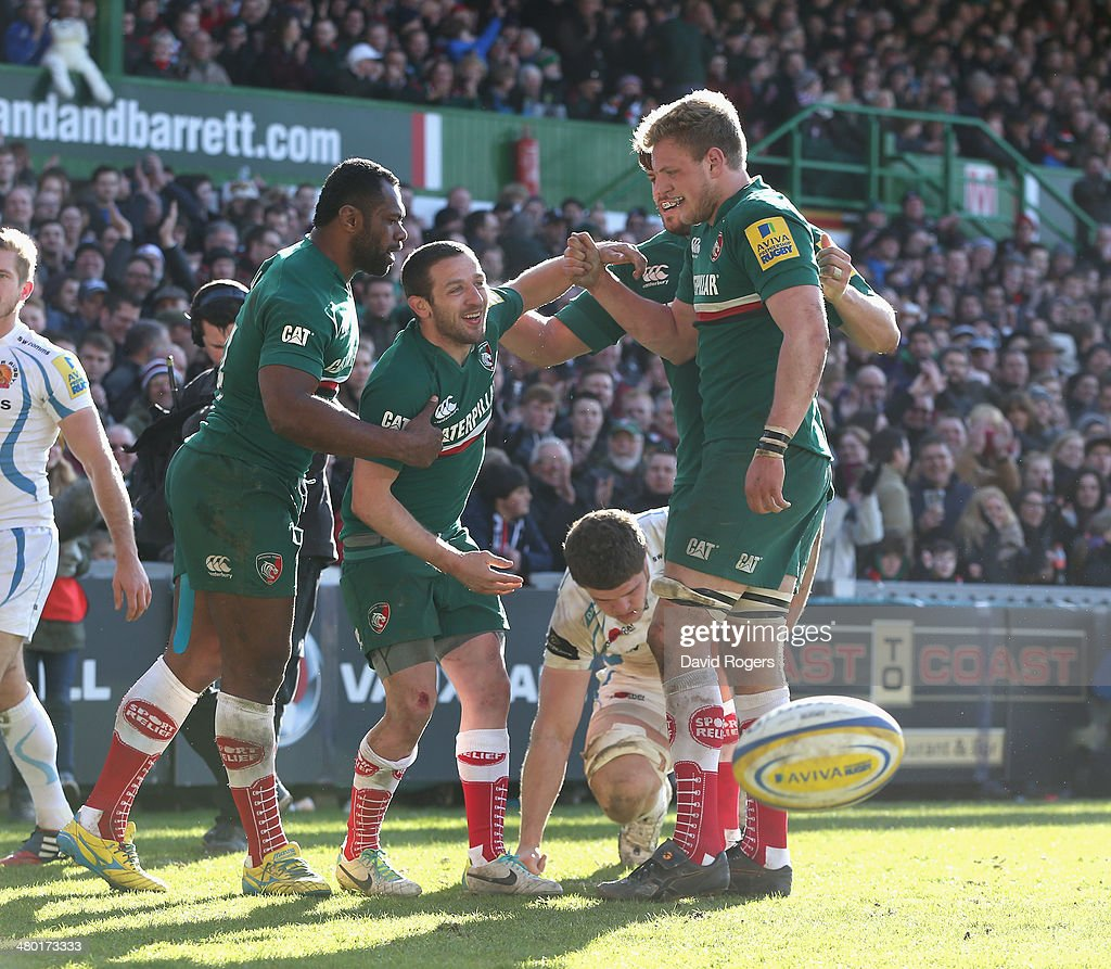 David Mele of Leicester is congratulated by team mates after scoring his second try during the Aviva Premiership match between Leicester Tigers and Exeter Chiefs at Welford Road on March 23, 2014 in Leicester, England.