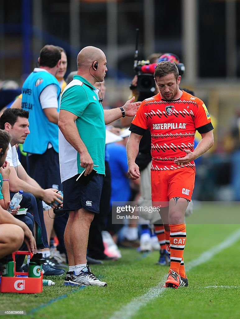 David Mele of Leicester Tigers leaves the field past <a gi-track='captionPersonalityLinkClicked' href=/galleries/search?phrase=Richard+Cockerill&family=editorial&specificpeople=609259 ng-click='$event.stopPropagation()'>Richard Cockerill</a>, Head Coach of Leicester Tigers after being shown a red card during the Aviva Premiership match between Bath and Leicester Tigers at the Recreation Ground on September 20, 2014 in Bath, England.