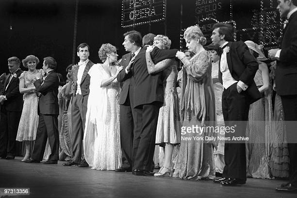 David Merrick embraces Wanda Richert who costars in the show after he announced the death of legendary choreographer and director Gower Champion at...