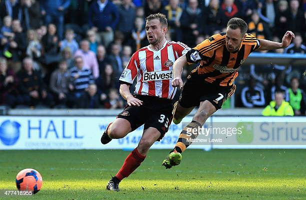 David Meyler of Hull City beats the tackle from Lee Cattermole of Sunderland to score his teams second goal during the FA Cup Quarter Final match...