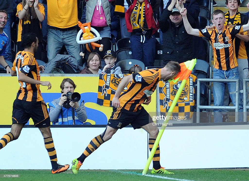 David Meyler of Hull City celebrates by headbutting the corner flag after scoring the second goal of the game for his side during the Budweiser FA...