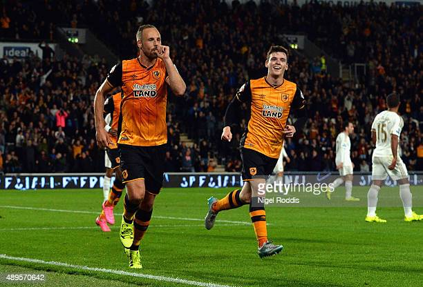David Meyler of Hull City celebrates scoring the opening goal with Andrew Robertson of Hull City during the Capital One Cup third round match between...
