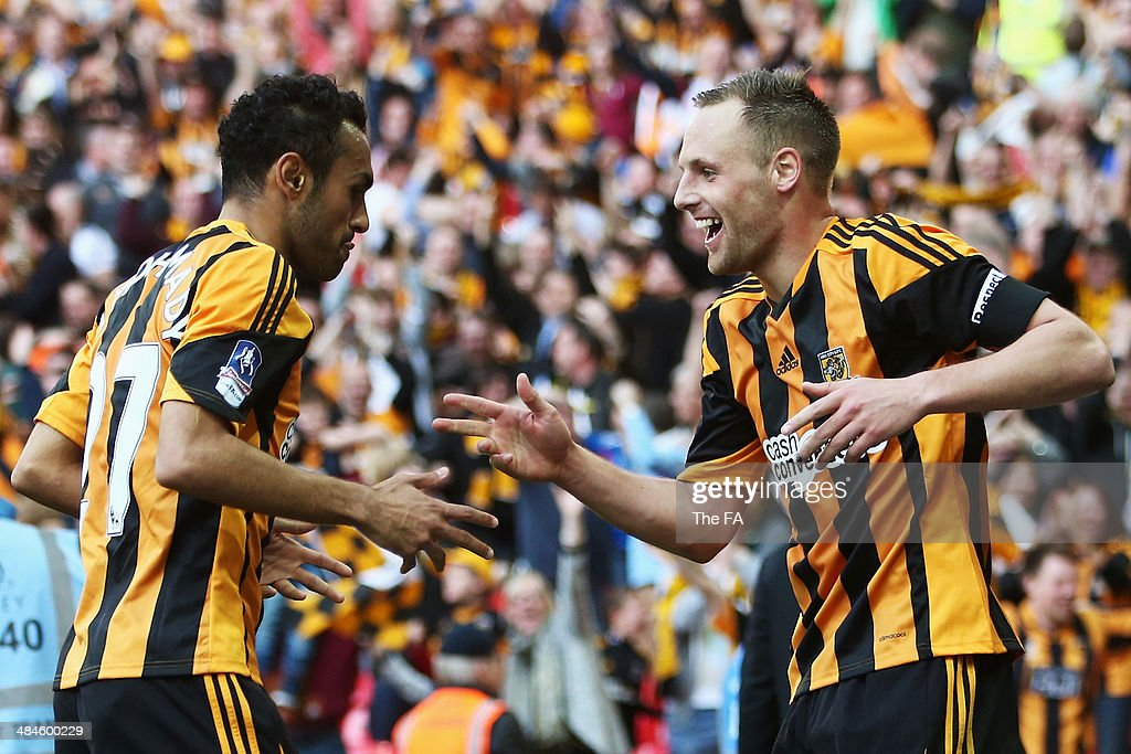 <a gi-track='captionPersonalityLinkClicked' href=/galleries/search?phrase=David+Meyler&family=editorial&specificpeople=5472116 ng-click='$event.stopPropagation()'>David Meyler</a> (R) of Hull City celebrates with team mate <a gi-track='captionPersonalityLinkClicked' href=/galleries/search?phrase=Ahmed+Elmohamady&family=editorial&specificpeople=7140369 ng-click='$event.stopPropagation()'>Ahmed Elmohamady</a> (L) after scoring their fifth goal during the FA Cup Semi-Final match between Hull City and Sheffield United at Wembley Stadium on April 13, 2014 in London, England.