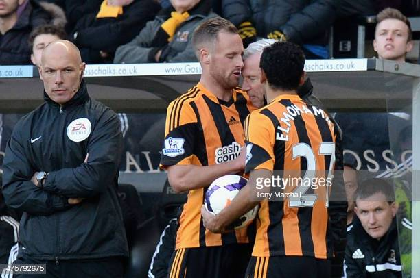 David Meyler of Hull City clashes with Alan Pardew Manager of Newcastle United during the Barclays Premier League match between Hull City and...