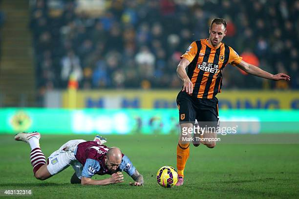 David Meyler of Hull City goes past the challenge from Alan Hutton of Aston Villa during the Barclays Premier League match between Hull City and...