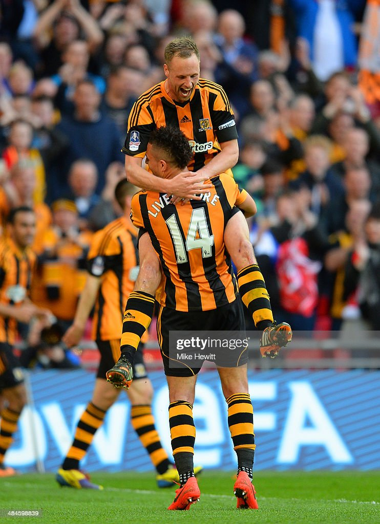 David Meyler of Hull City is congratulated on scoring their fifth goal by Jake Livermore of Hull City during the FA Cup with Budweiser semi-final match between Hull City and Sheffield United at Wembley Stadium on April 13, 2014 in London, England.