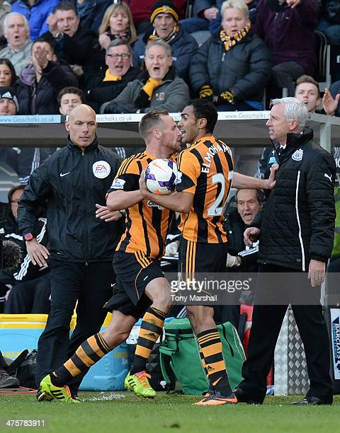 David Meyler of Hull City pushes Alan Pardew manager of Newcastle United during the Barclays Premier League match between Hull City and Newcastle...