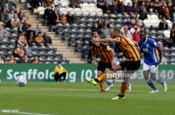 David Meyler of Hull City shoots to score a penalty during the Sky Bet Championship match between Hull City and Birmingham City at KCOM Stadium on...